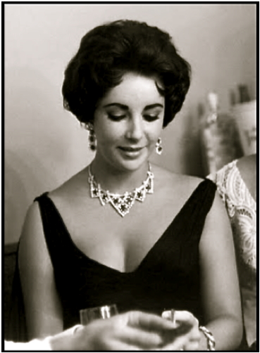 elizabeth-taylor-in-1958-with-her-cartier-ruby-and-diamond-necklace-offered-in-1957-by-mike-todd-photofest